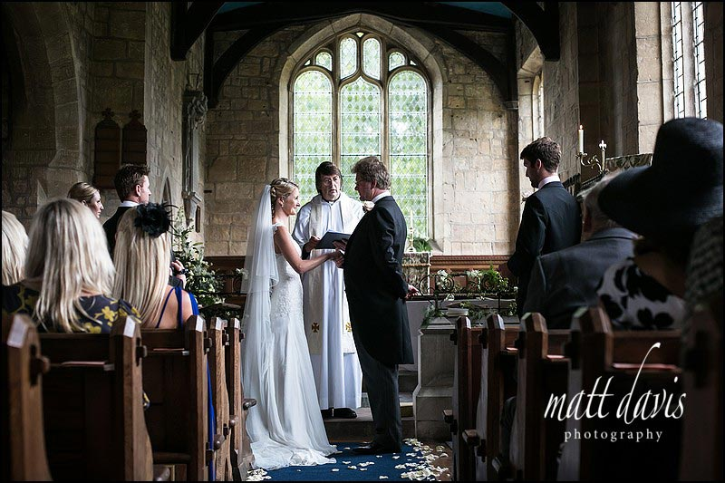 Bride and groom saying vows in St Andrew's church