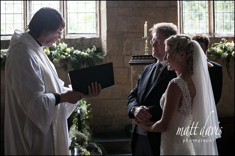 Couple getting married at St Andrew's Church in Naunton, Gloucestershire