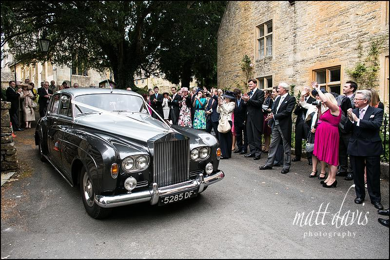 Silver grey Rolls Royce wedding car