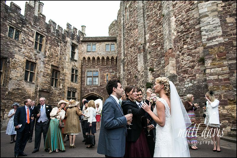 Wedding guests in Berkeley Castle courtyard