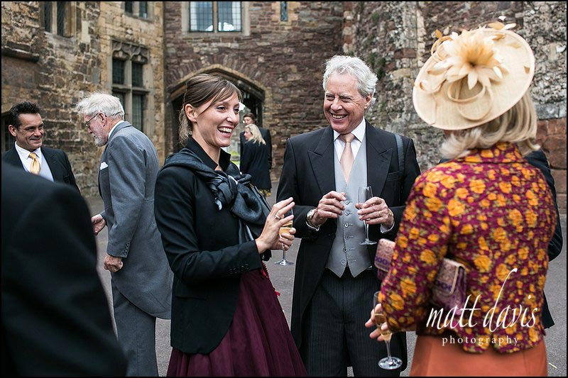 Wedding guests in Berkeley Castle courtyard during the drinks reception