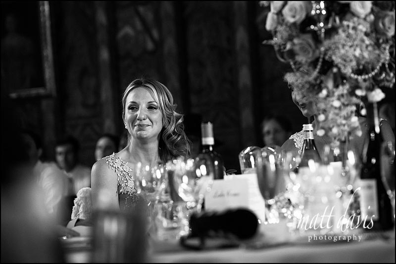 Bridesmaid crying during wedding speeches at Berkeley Castle