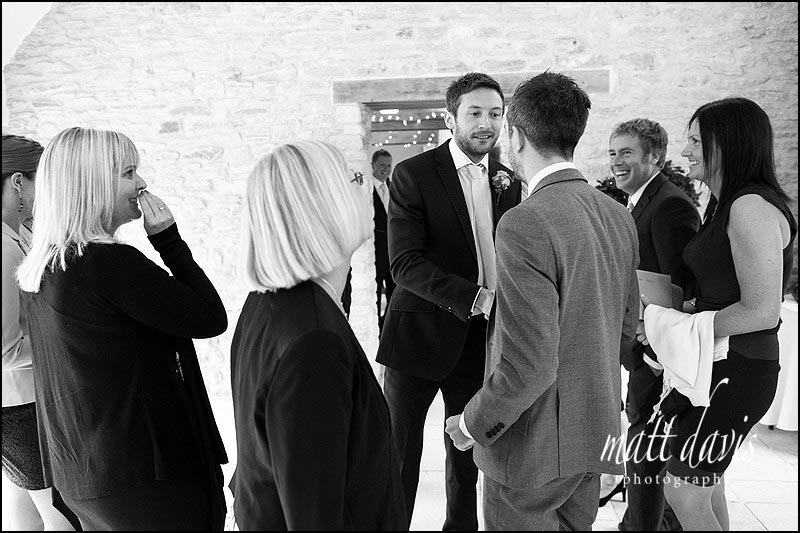 Black & White reportage wedding photography at Kingscote Barn