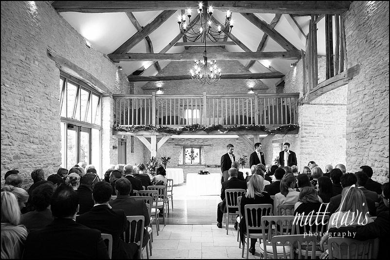 Inside Kingscote Barn ready for a wedding ceremony