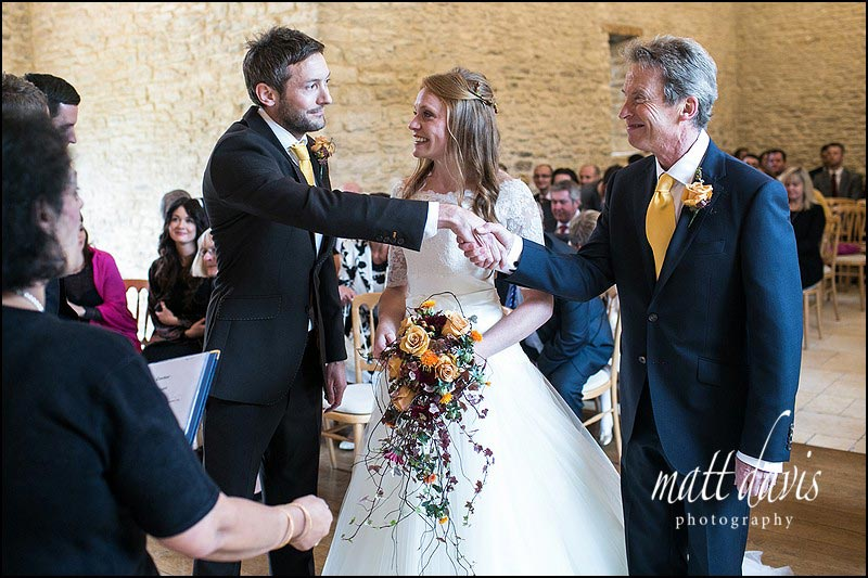 Father of the bride giving her away at Kingscote Barn civil ceremony
