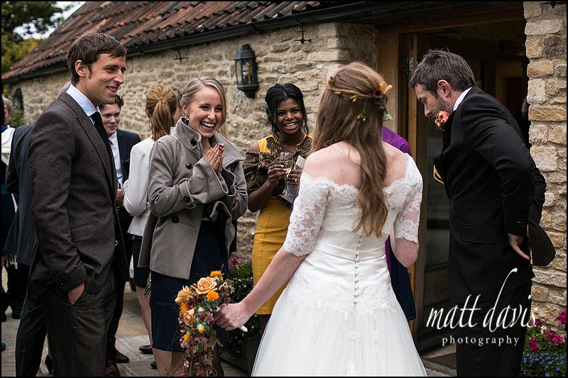 Natural wedding photos outside Kingscote Barn, Gloucestershire