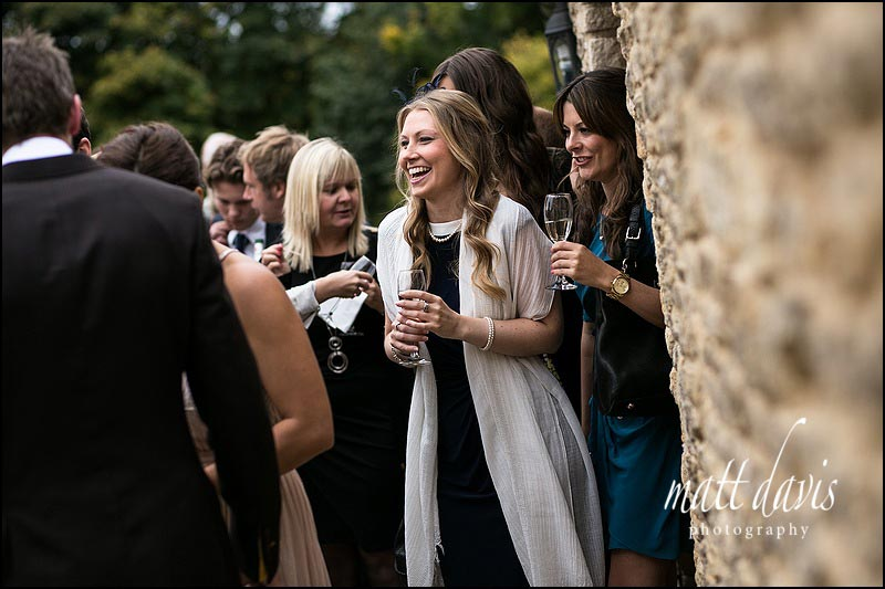 Natural wedding photos of guests at Kingscote Barn, Gloucestershire