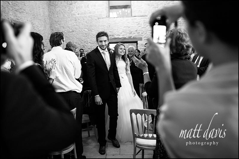 Photo of bride & groom inside Kingscote Barn
