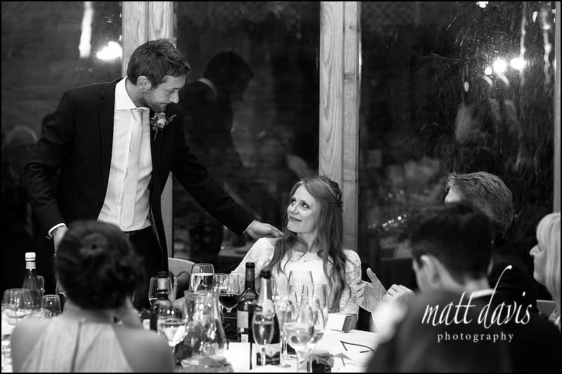 Bride and groom at Kingscote Barn wedding during speeches