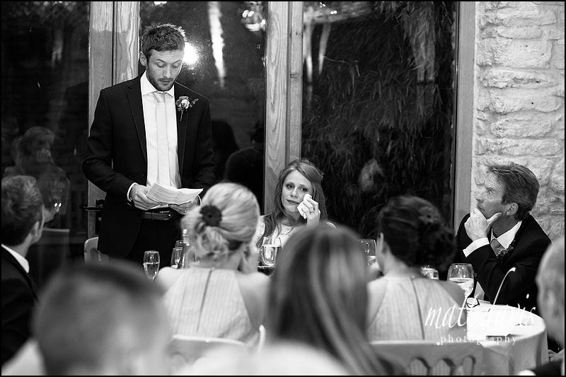 Kingscote Barn wedding photographer Matt Davis captured this tender moment during speeches