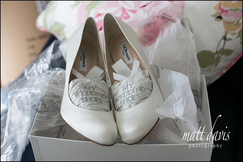 Wedding shoes in a box with 'my wedding shoes' written on them