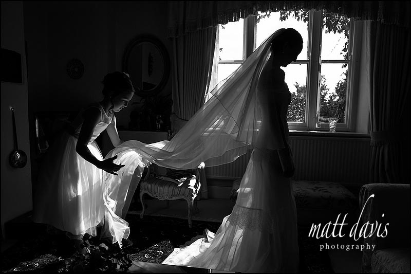 Stunning black and white photo os a long wedding veil taken by Gloucestershire wedding photographer Matt Davis