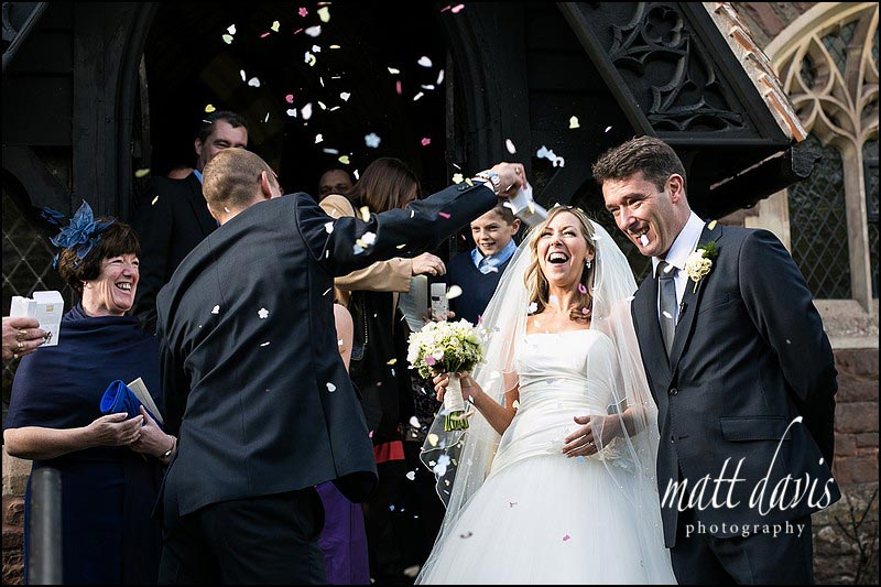 Throwing confetti outside St Peter's church near Clearwell Castle, Gloucestershire
