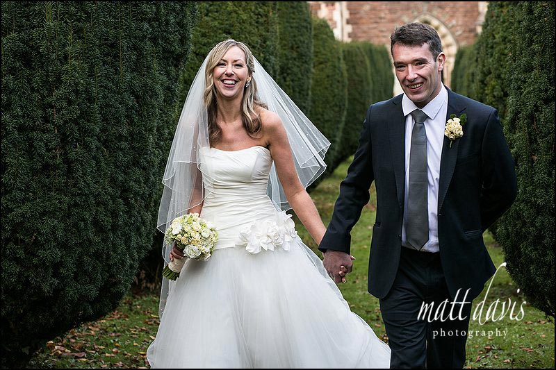 Wedding photo of bride and groom outside St Peter's church near Clearwell castle