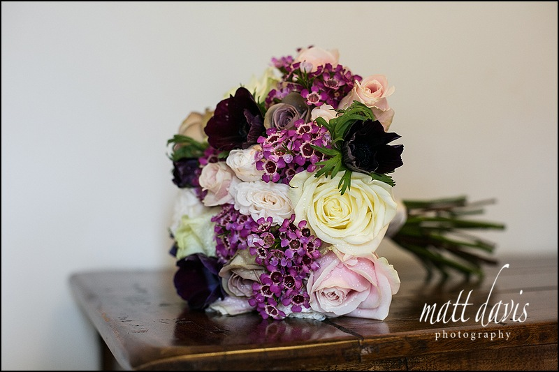 wedding bouquet with purple flowers and white roses