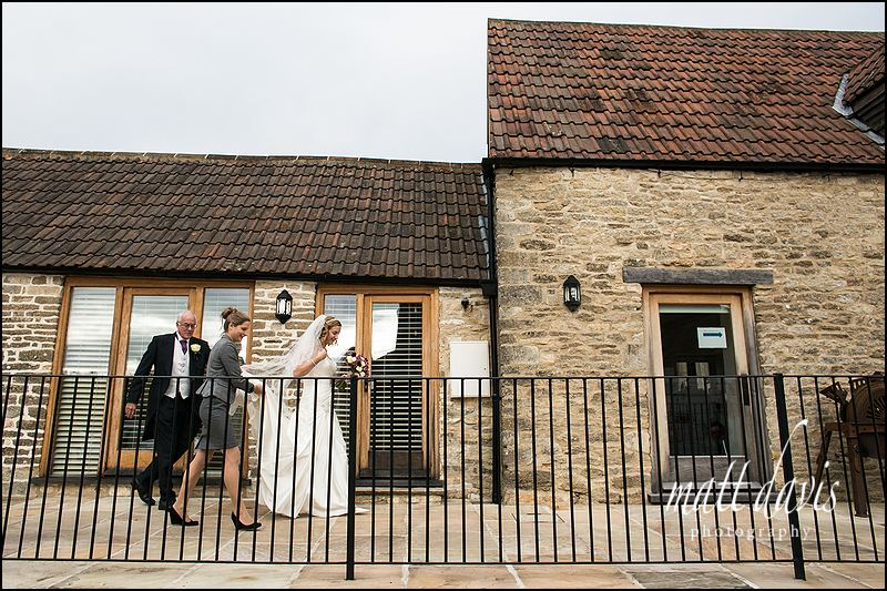 bride seeing registrar at Kingscote Barn