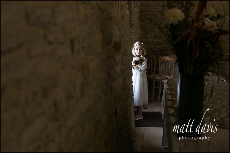 bridesmaid standing near a door at Kingscote Barn wedding