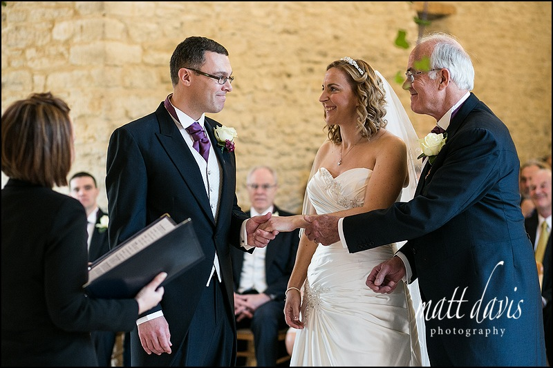 father of bride giving away bride at Kingscote Barn wedding