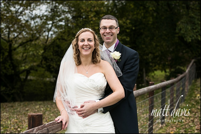 Kingscote Barn wedding couple outside in the grounds