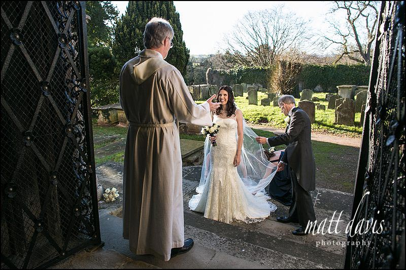 Berkeley Castle Winter Wedding Photos as the bride arrives at Berkeley Church, Gloucestershire