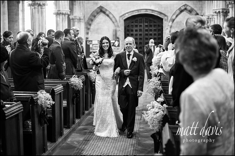 Photos by Matt Davis of bride and father walking down the aisle in Berkeley Church