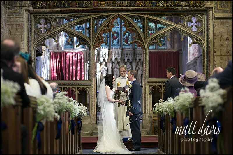 Photos inside Berkeley Church, Gloucestershire during the wedding ceremony