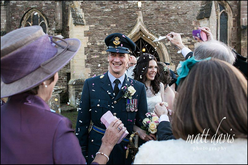 Confetti being thrown at a wedding at Berkeley Church, near Berkeley Castle, Gloucestershire