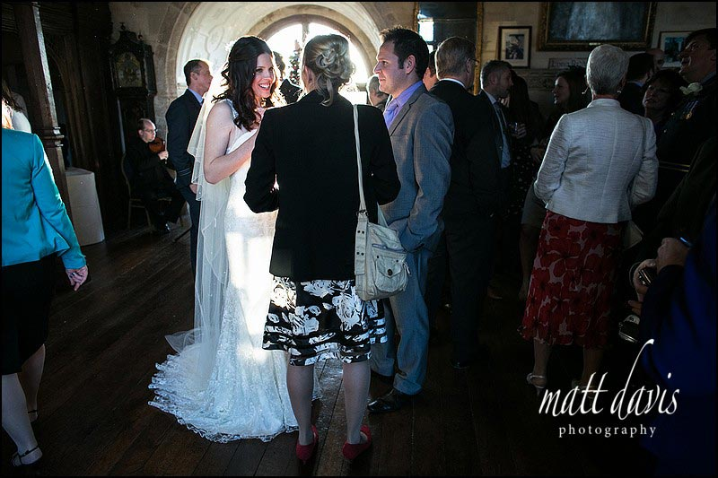 Beautifully lit bride at Berkeley Castle drinks reception