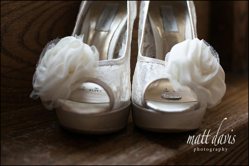 Fantastic cream wedding shoes with large flower and sixpence inside for good luck