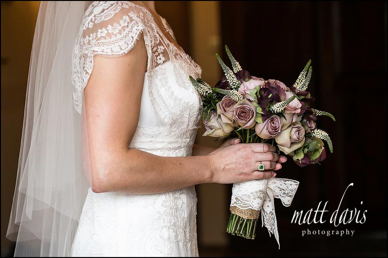 Dusky pink roses in wedding bouquet held by bride at Stanton House Hotel wedding