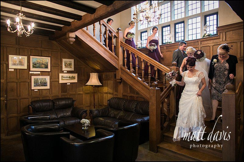 bride & bridesmaids walking down the staircase at Stanton House Hotel wedding