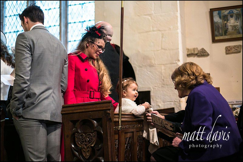 Baby in a church during the wedding ceremony