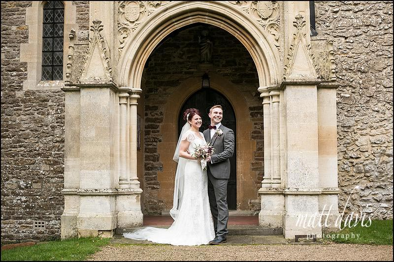 Relaxed wedding photos of bride and groom outside St. Leonard's Church, Stanton Fitzwarren