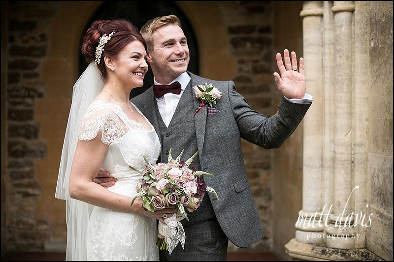 Natural wedding photos of bride and groom outside St. Leonard's Church, Stanton Fitzwarren