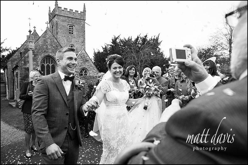 Black and white wedding photos of bride and groom outside St. Leonard's Church, Stanton Fitzwarren