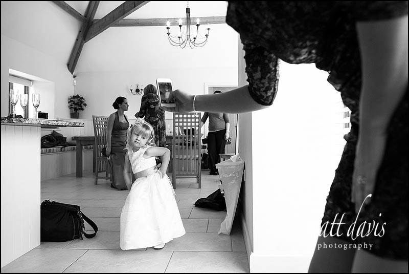 Bridesmaid posing for photos at Kingscote Barn wedding