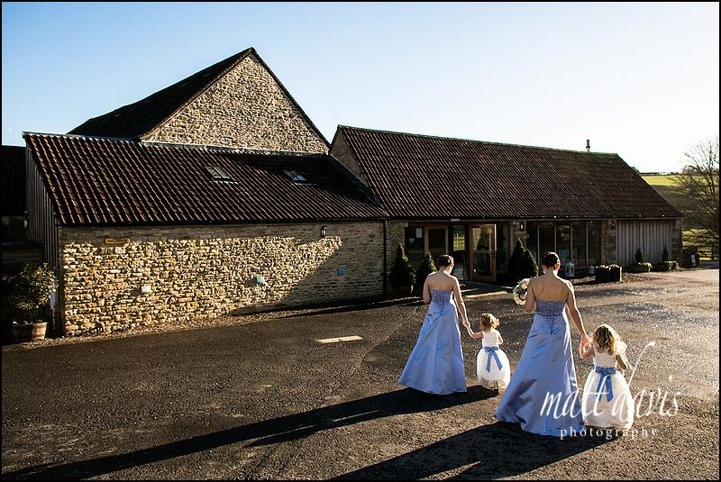 Winter weddings at Kingscote Barn showing bridesmaids in warm sun