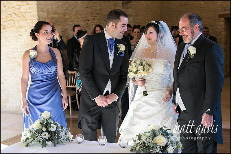 Bride meeting groom for first time at a civil wedding ceremony in Kingscote Barn Gloucestershire