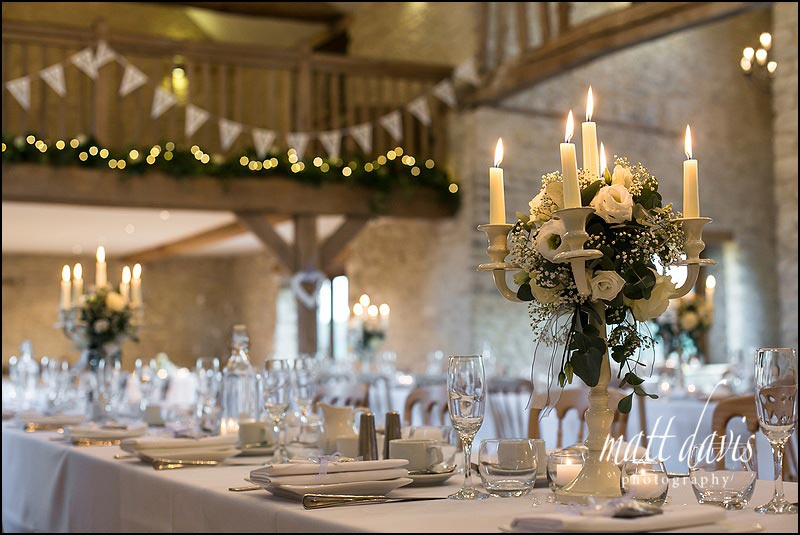 Candle arbor table decorations for weddings at Kingscote Barn