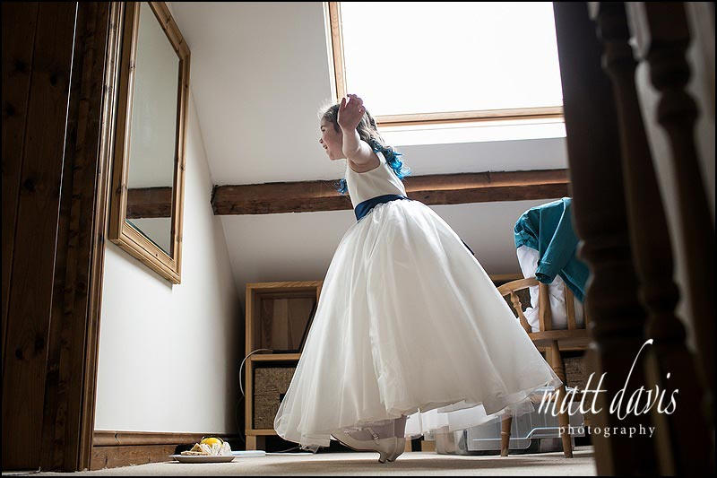 Documentary wedding photographer Matt Davis took this photo of a flower girl playing in front of a mirror