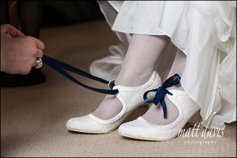 white wedding shoes with blue ribbon laces