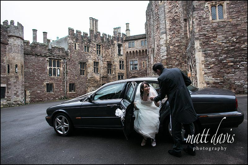 Bride stepping out of Wedding car at Berkeley Castle