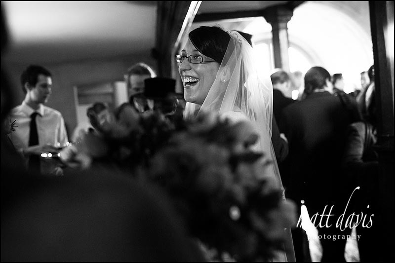 Black and white photo of Bride smiling at Berekely Castle wedding