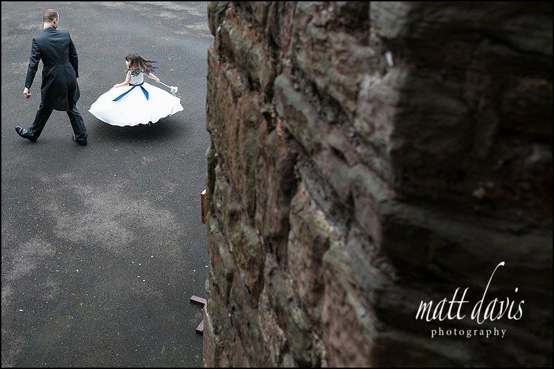 Documentary wedding photo of bridesmaid at Berkeley Castle