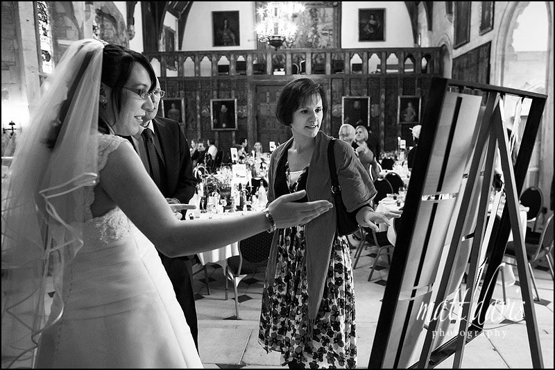 Guests looking at a wedding table plan