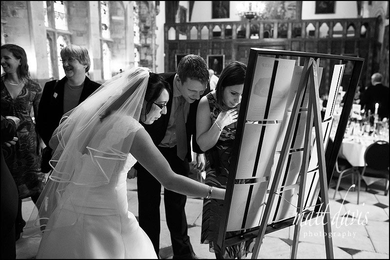 Bride pointing to a wedding table plan