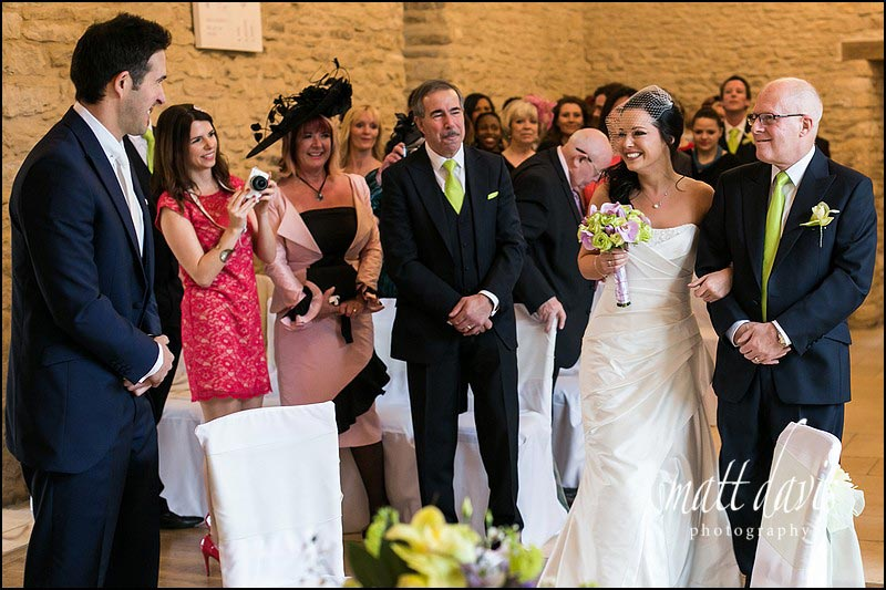 An emotion greet by the bride at a Wedding at Kingscote Barn