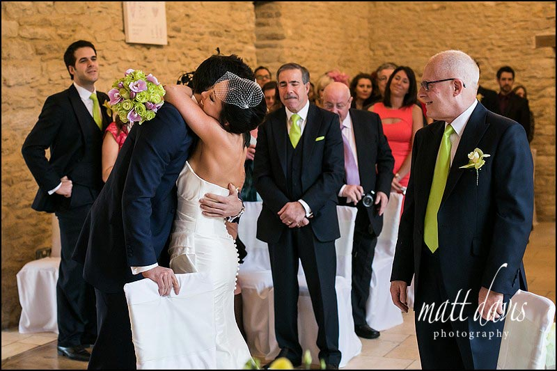 Natural wedding photography during the ceremony at Kingscote Barn