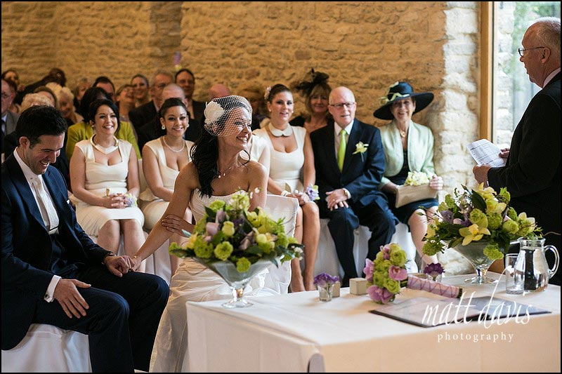 A tender moment during the wedding ceremony at Kingscote Barn