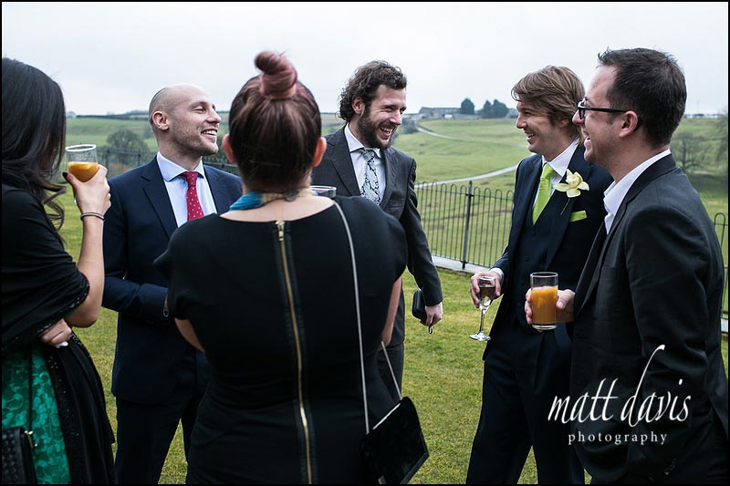 Wedding guests on the lawn at Kingscote Barn